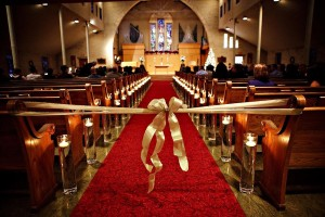 Picture of sanctuary decorated for wedding.